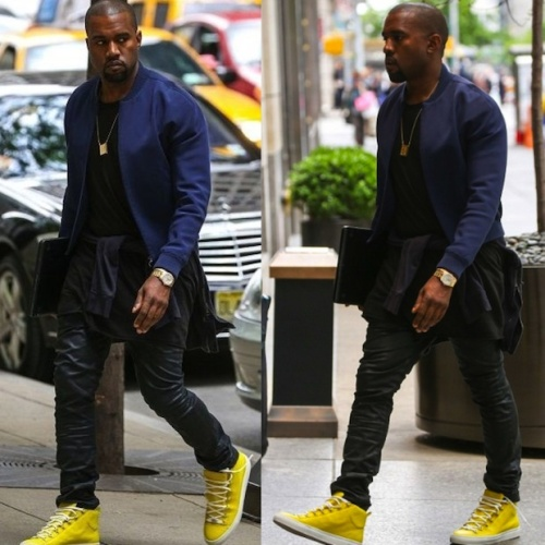 Kanye West in neon sneakers and his infamous leather jogging pangs. from The Shadow League