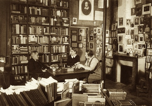 James Joyce, Sylvia Beach and Adrienne Monnier in the original Shakespeare & Co., 1920.