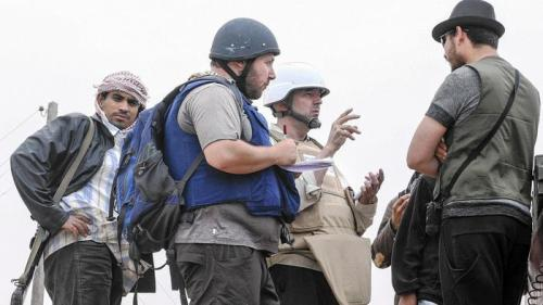 Steven Sotloff, in the black helmet speaks with Libyan rebels in 2011. (Etienne de Malglaive, Getty Images)